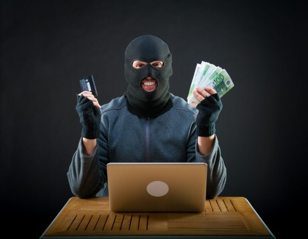 Cybercriminal with cash