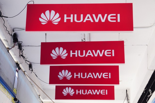 Four Huawei signs