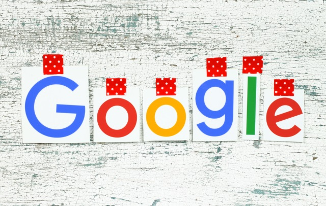 Google logo on white wood