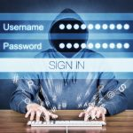 Hacker typing username and password