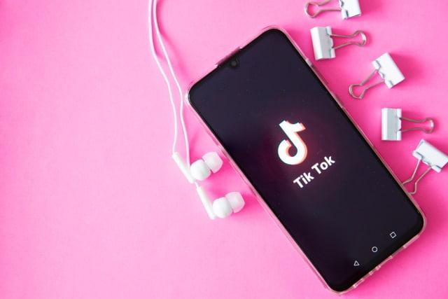 TikTok with pink background