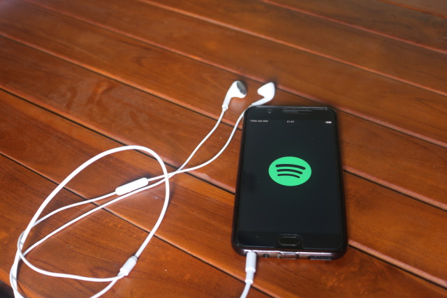 Spotify on phone with earphones