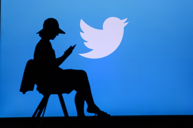 Twitter logo and a woman in silhouette