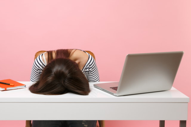 Frustrated woman at laptop