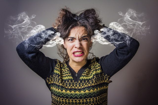 Furious woman with steaming ears