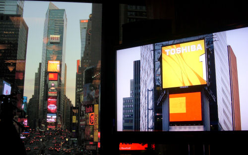The Toshiba HD LED sign in Times Square is juxtaposed against a close-up shot, to the right, of the same display from Toshiba's HD camera.