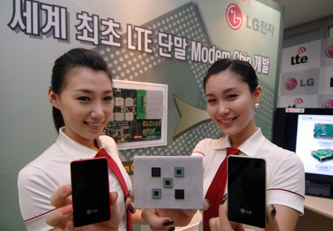 Representatives from LG Electronics show off their new LTE chipset for handsets and mobile devices, at a trade event in South Korea.
