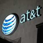AT&T logo at night on the side of a building, alternate main story banner