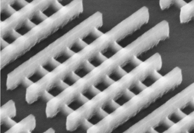 Intel's 22nm Tri-Gate Transistor, this image shows the vertical fins of the tri-gate transistors passing through the gates