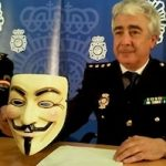 BIT commissioner Manuel Vazquez holds up the trademark Anonymous Guy Fawkes mask 200 pix